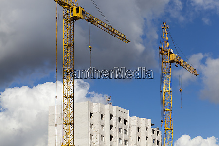 yellow construction cranes