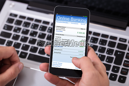 person doing online banking on mobile