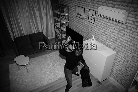 thief with bag and crowbar in