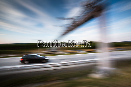 cars going fast on a highway