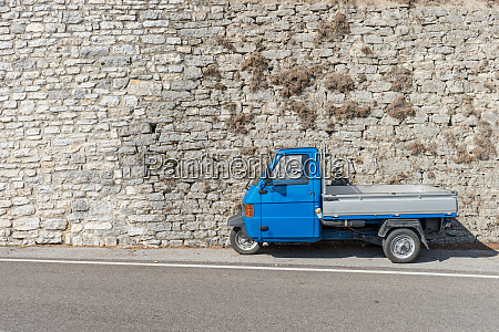 blue small transport vehicle