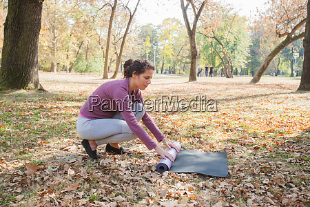 fit woman prepare for exercise rolling