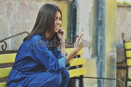 young beautiful asian girl looks sitting