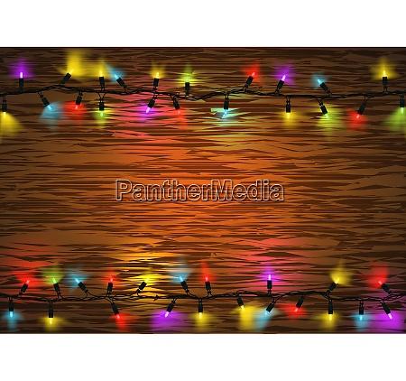 colorful christmas led lights over wood