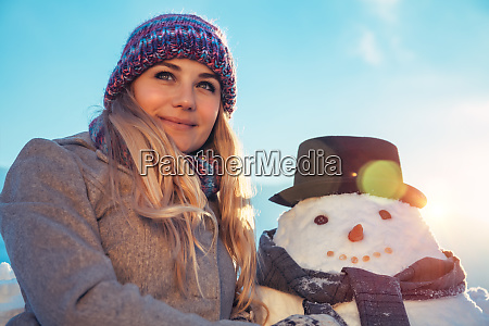 happy female with snowman
