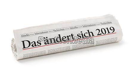 rollte zeitung mit der deutschen schlagzeile