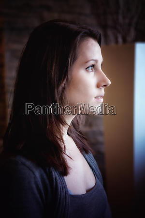 portrait of brunette woman looking out