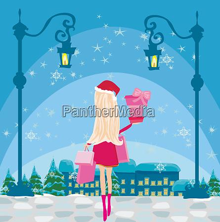 schoene maedchen auf winter shopping karte