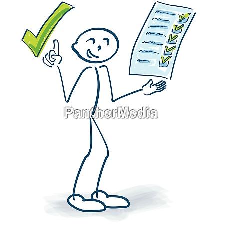 steckfigur mit zwischenablage prueft eine checkliste