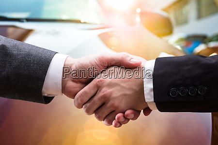 two business partners shaking hands