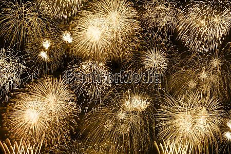 silvesterfeuerwerk goldene goldene hintergrundfeuerwerk