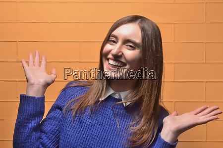 cheerful beautiful girl laughing and waving