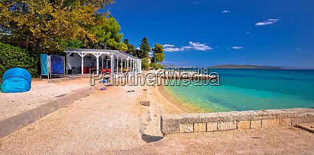 idyllic turquoise beach and bar near