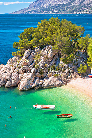 idyllic emerald beach and boats in