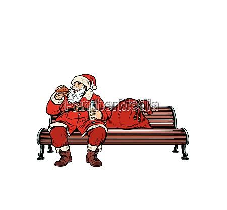 weihnachtsmann isst fast food burger park