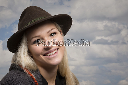 happy young woman with loden hat