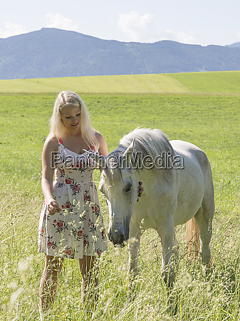 young woman and arabian mare
