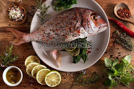 fresh raw fish with spices and