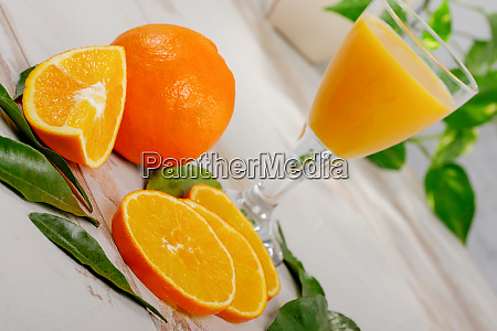 orange and glass of orange juice
