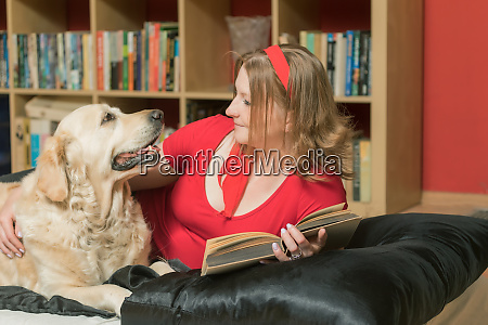 relaxing with a dog and book