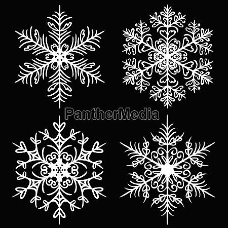 decorative snowflakes set on black background