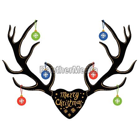christmas decoration on reindeer horns silhouette