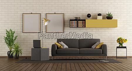 modernes wohnzimmer mit sofa und ziegelwand