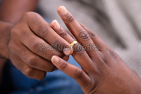 man putting an engagement ring on