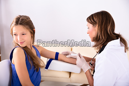 doctor taking blood sample of an