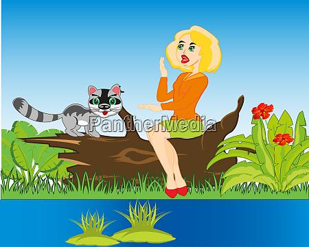 maedchen mit katze auf der natur