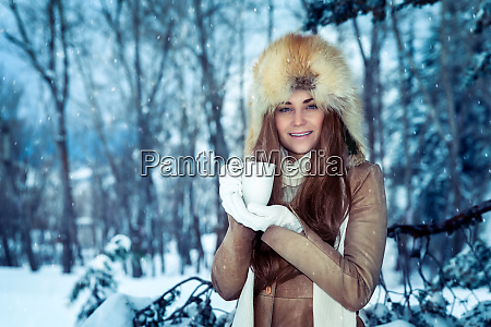 pretty woman in the winter park