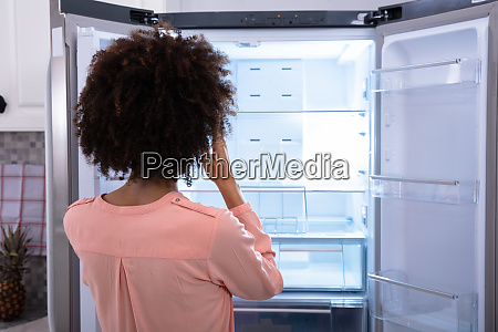 woman standing in front of empty