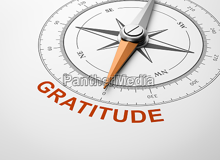compass on white background gratitude concept