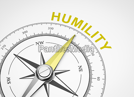 compass on white background humility concept