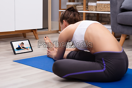 athletic woman doing stretching exercise