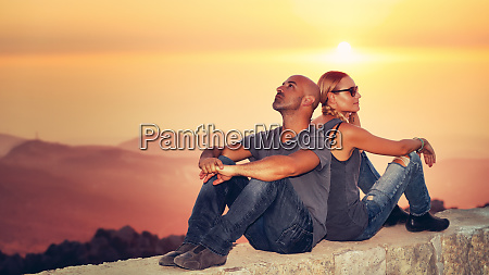 happy couple enjoying sunset view