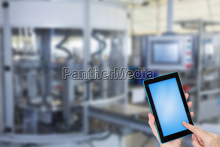 industry concept with holding blank tablet