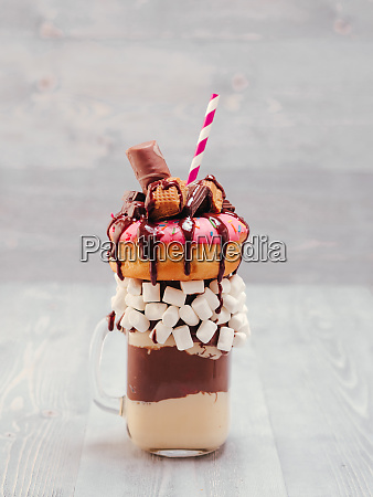 freakshake with donuts on gray wooden