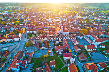 colorful sunset above medieval town of