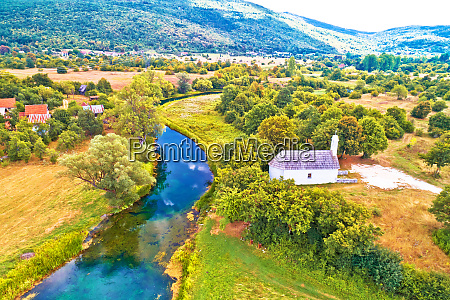 stone church by gacka river aerial