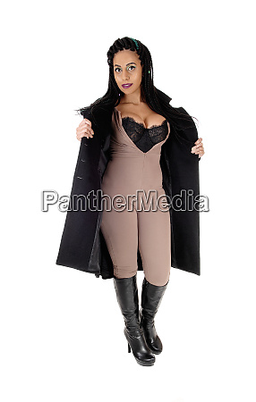 woman standing in body suit and
