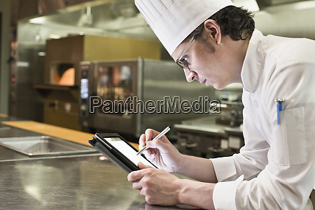 a caucasian male chef working on