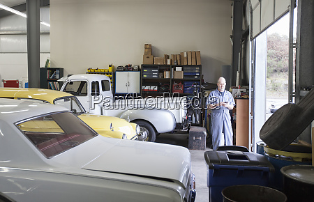 a mechanic standing in an auto