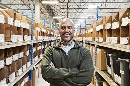 a black warehouse worker standing near
