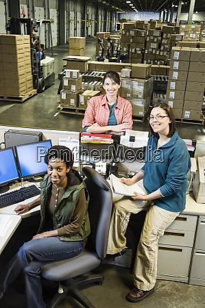 a team of three female warehouse