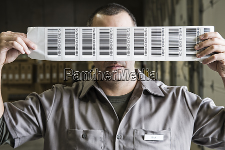a warehouse worker holding up a