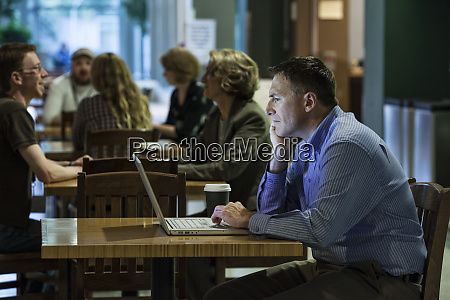 a caucasian businessman working on a