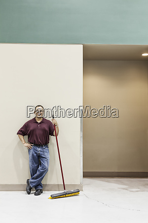 an hispanic workman standing in a