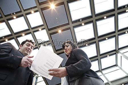 two business people going over paperwork
