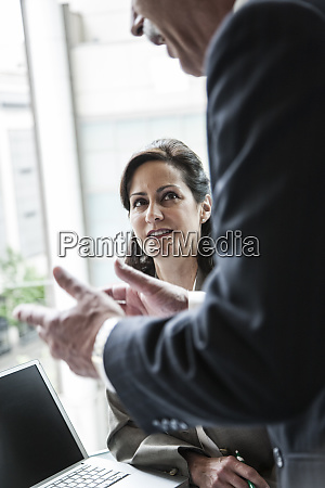 a caucasian businesswoman listening to a